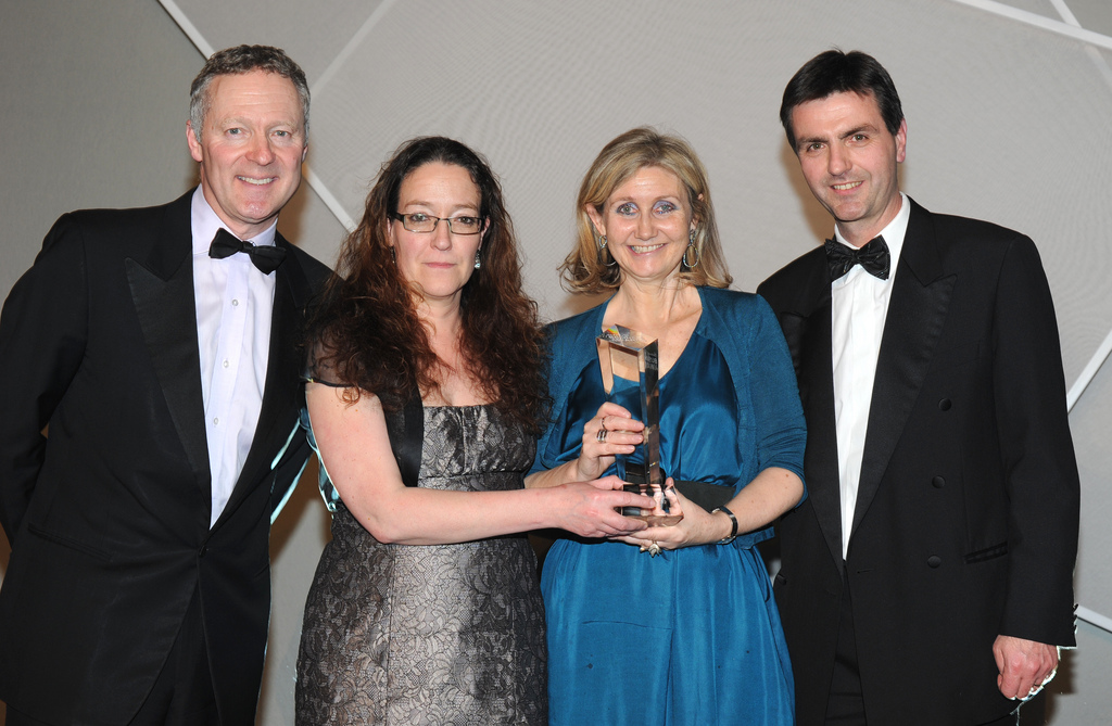 Cate Searle and Fiona Martin receive their award from Rory Bremner