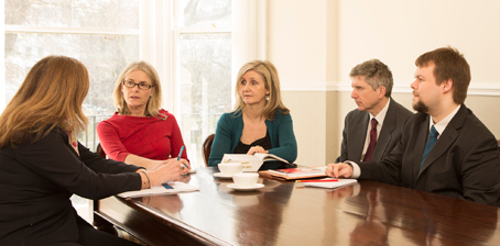 The employment team meeting to discuss a case