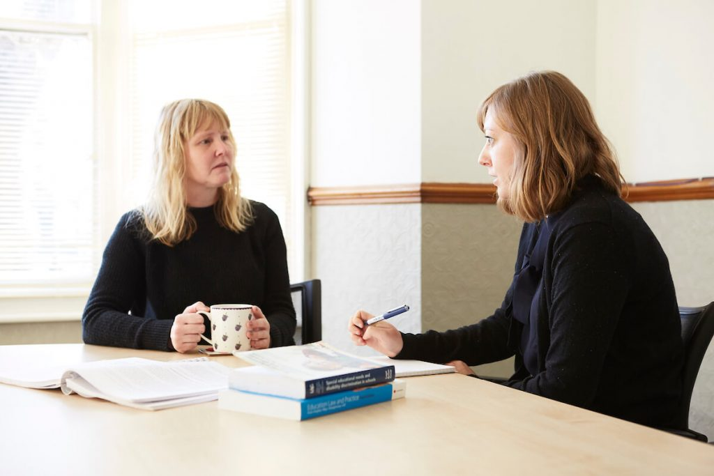 SEN Solicitor speaks with a client about appealing an NHS Children's Continuing Care Decision